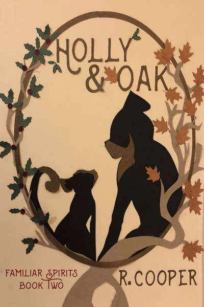Cover for Holly and Oak. Two familiars--a cat and a dog--sit amid oak leaves and sprigs of holly.